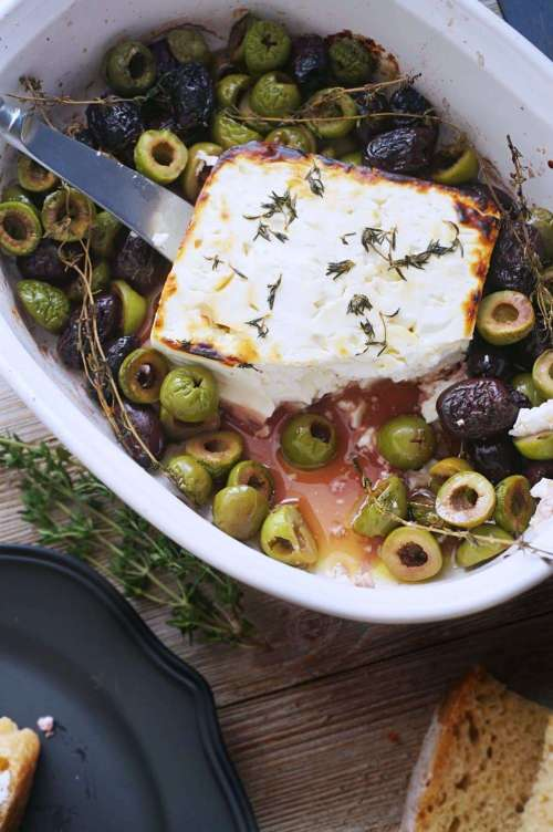Baked Feta with Olives Thyme & Honey is your new favorite appetizer! Fancy as all get out, but oh so easy to put together. Perfect for date night in or for when you have guests. #ad #feta #appetizer #partyfood