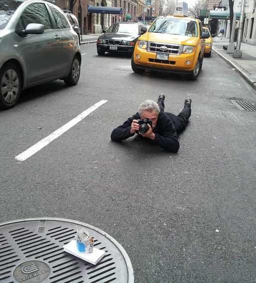 Battman shooting in the street.