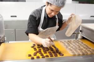 Working at Jacques Torres Chocolate. Photo by Kara Chin.