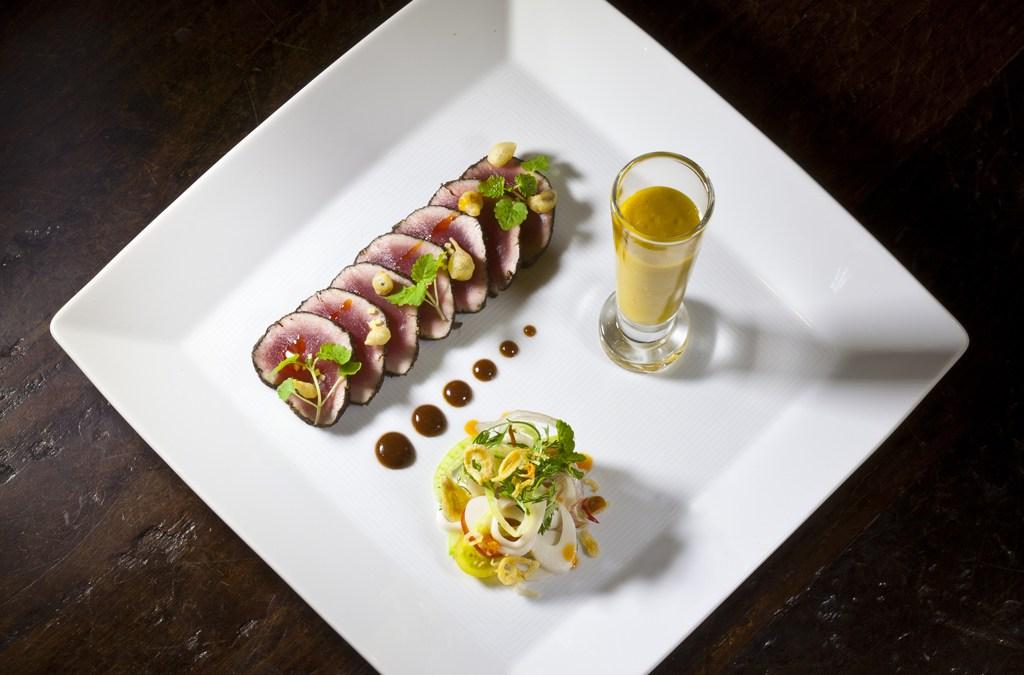 Tuna Carpaccio with a Tamarind Soy Sauce, Mango-Basil Gazpacho, and Palm Hearts Salad from Executive Chef Ashfer Biju