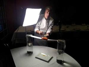 Chef Eric Ripert preparing his dish for the Street Eats book. Photo by Battman.
