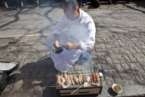 Chef Jean-George Vongerichten cooking on the sidewalk in NYC for the Street Eats book. Photo by Battman.