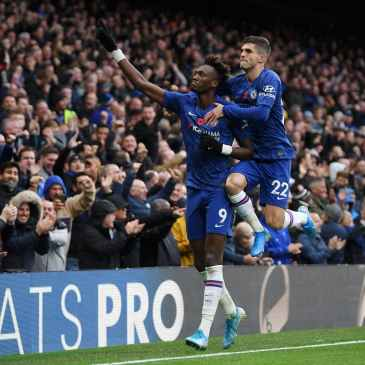 Tammy Abraham and Christian Pulisic celebrate after scoring for Chelsea at Stamford Bridge against Crystal Palace.
