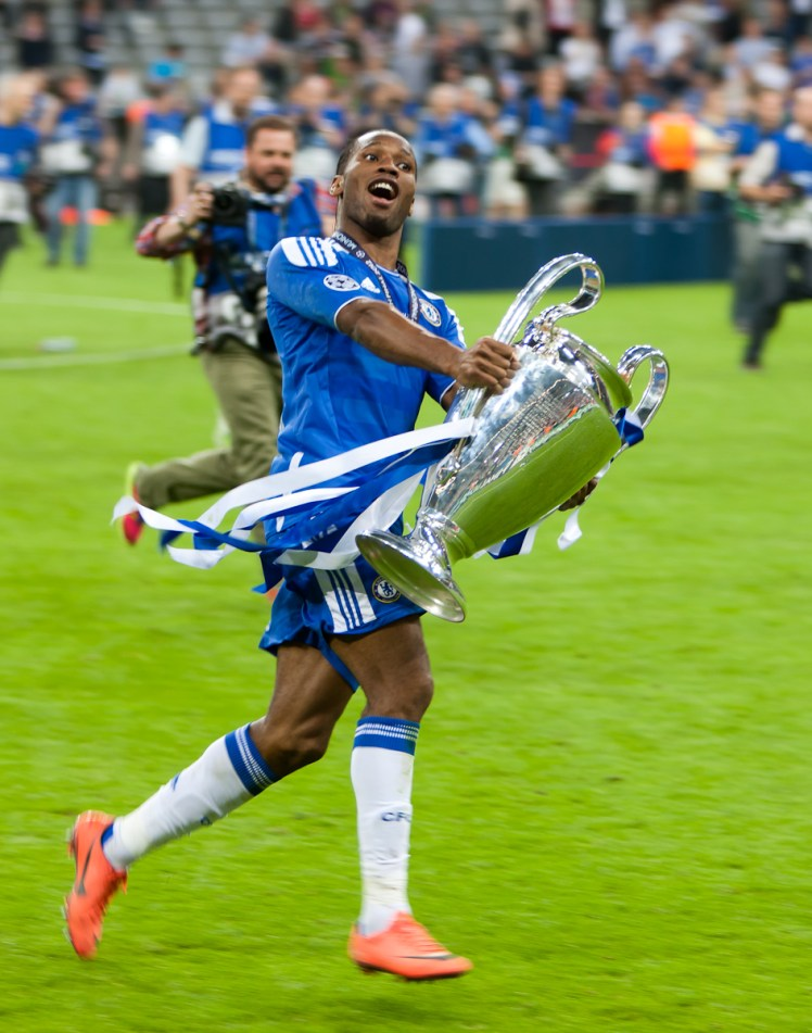 Didier Drogba shows off the Champions League trophy to Chelsea fans after defeating Bayern Munich on penalties in the Champions League final on 19th May 2012. (Photo by Popperfoto via Getty Images/Getty Images)