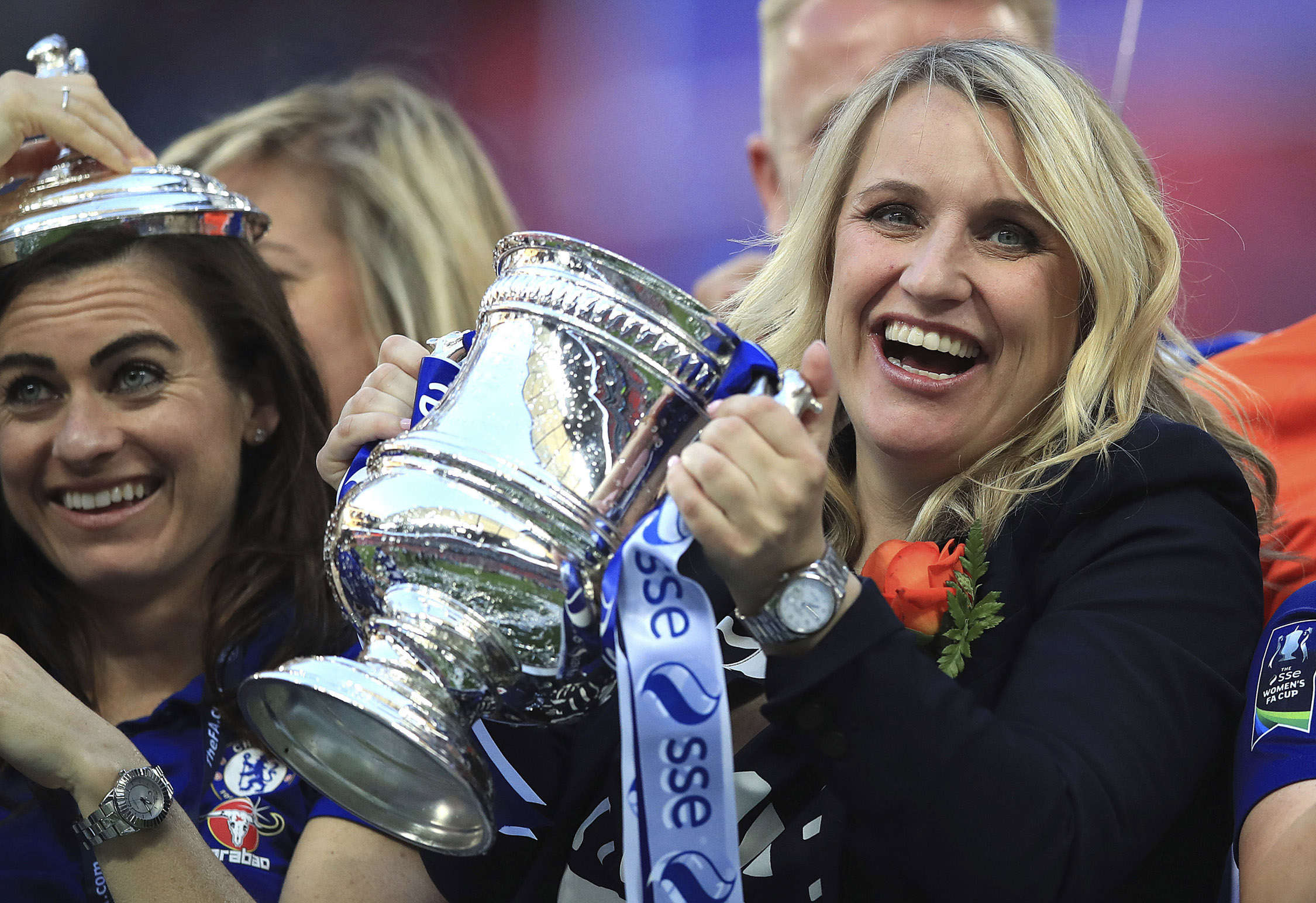 Chelsea Ladies manager Emma Hayes, right, celebrates with the trophy after the final whistle after beating Arsenal Women's team during the Women's FA Cup Final at Wembley Stadium in London, could Thomas Tuchel be there later in the season?