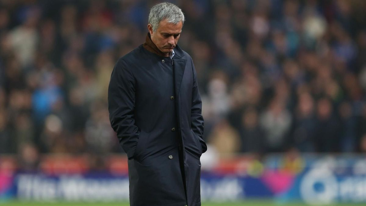 Jose Mourinho looking down at the floor.
