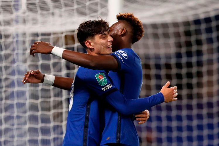 Chelsea's German midfielder Kai Havertz (L) celebrates with Chelsea's English striker Tammy Abraham after scoring his team's fifth goal  during the FA Cup third round football match between Chelsea and Barnsley at Stamford Bridge in London on September 23, 2020. (Photo by Alastair Grant / various sources / AFP) /