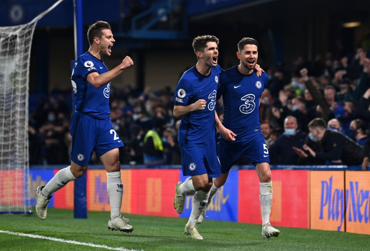 LONDON, ENGLAND - MAY 18: Jorginho of Chelsea celebrates after scoring their sides second goal from the penalty spot with team mates Cesar Azpilicueta and Christian Pulisic during the Premier League match between Chelsea and Leicester City at Stamford Bridge on May 18, 2021 in London, England. A limited number of fans will be allowed into Premier League stadiums as Coronavirus restrictions begin to ease in the UK following the COVID-19 pandemic. (Photo by Glyn Kirk - Pool/Getty Images)