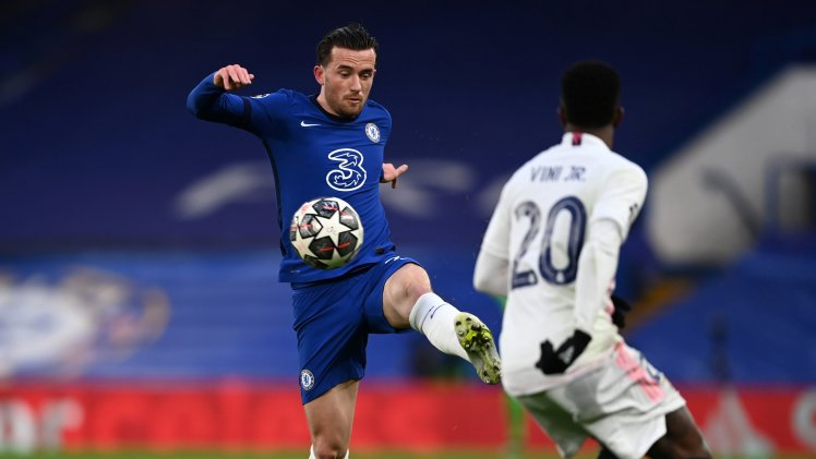 Ben Chilwell in action for Chelsea against Vinicius Jr of Real Madrid.