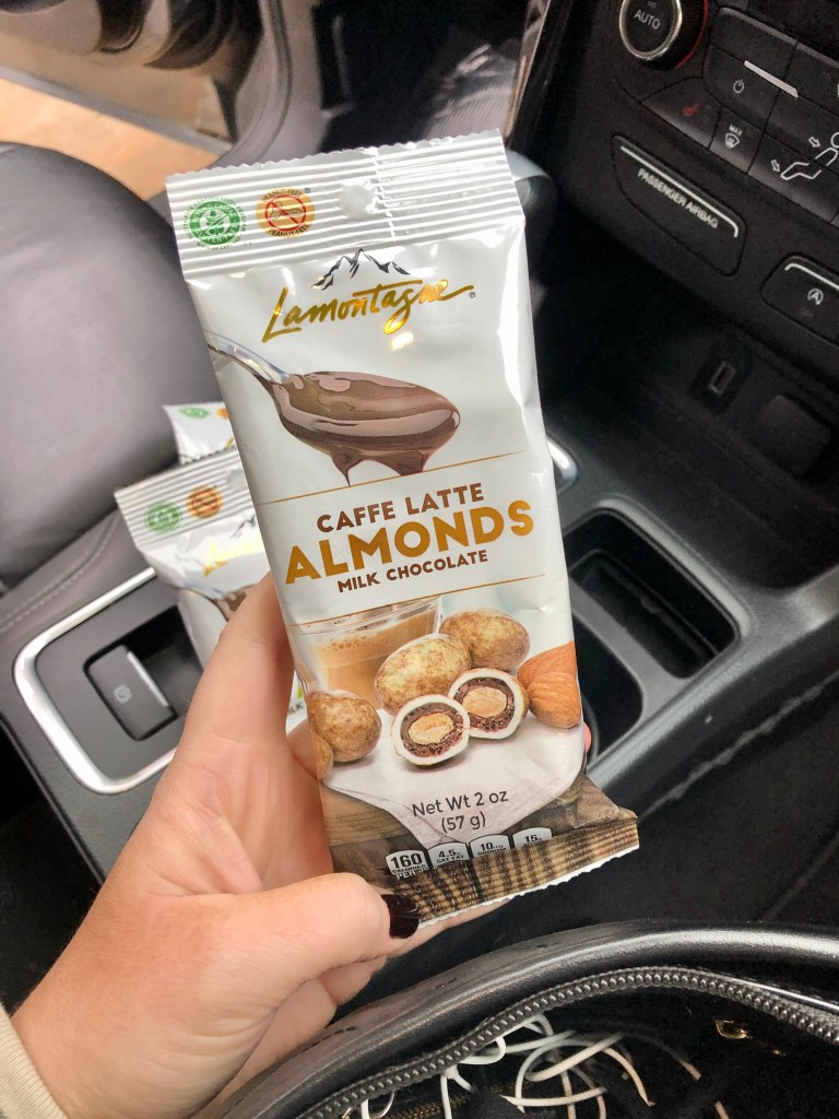 Lamontagne chocolate is peanut free and Kosher with around 160 calories a pack (2oz). A better alternative for all other snacks you might take with you on the road!