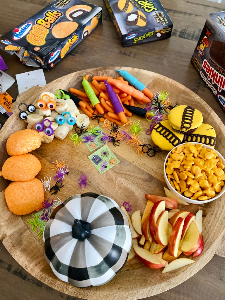 Halloween snack board is fun to make for the kids this holiday. Add your favorite snacks, sweets and treats!