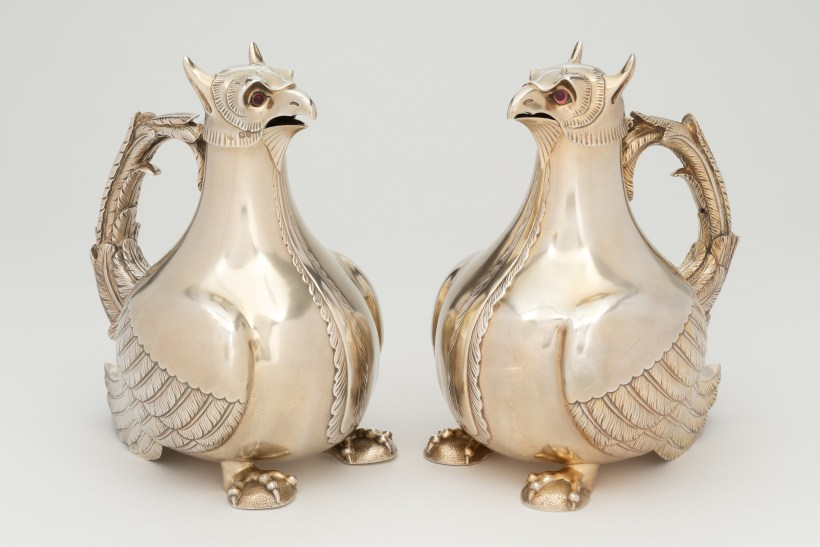A pair of sliver gilt claret jugs