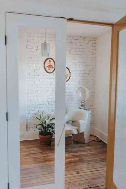 White office with exposed brick walls