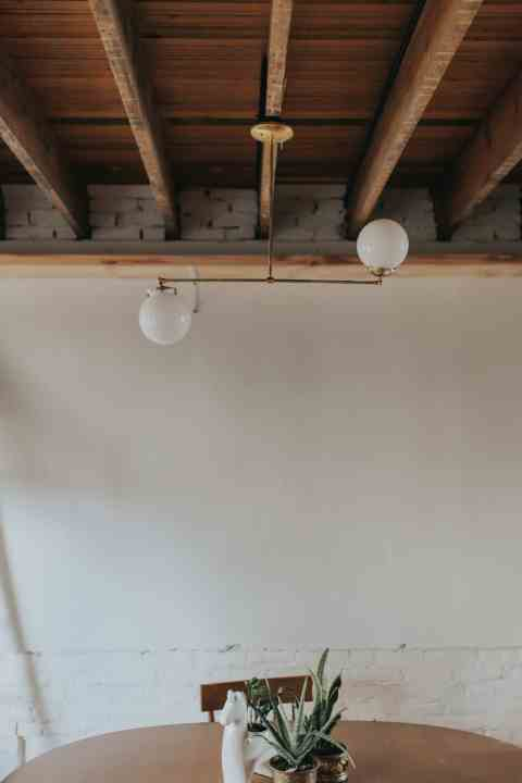 creative light fixture above dining room table