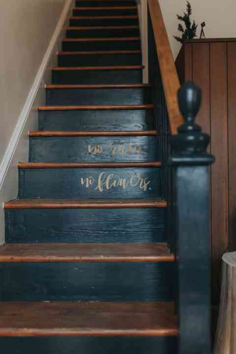 black stairs with writing renovation