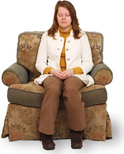 Meditating in chair