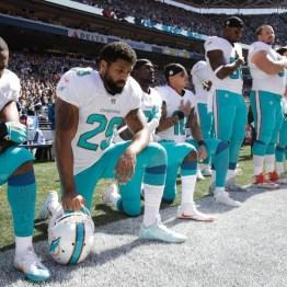 Miami kneeling