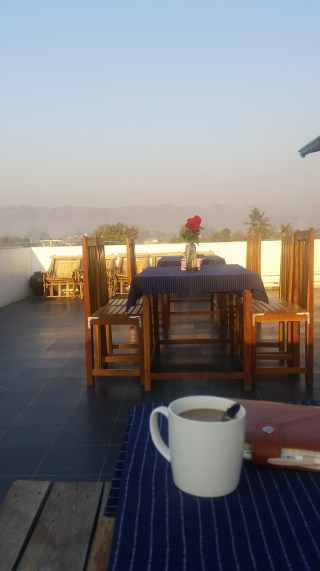 breakfast on the roof at song of travel hostel