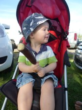 Sitting nicely before discovering the bliss of a chocolate covered frozen banana at the farmers' market