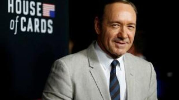 Kevin Spacey poses at the premiere for the second season of the television series House of Cards at the Directors Guild of America in Los Angeles, California, 13 February 2014