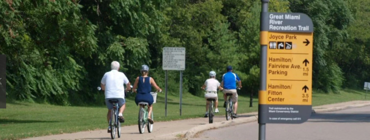 People riding bicycles in joyce park located in fairfield ohio