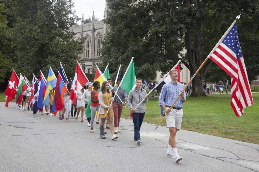Students+carrying+flags+at+Convocation.
