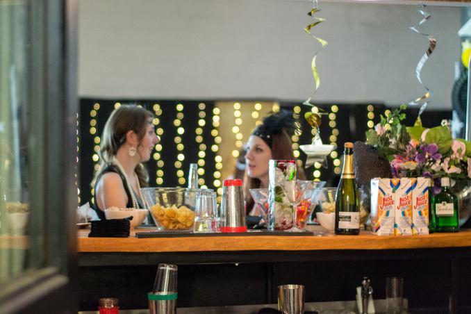 Women drinking at a bar.