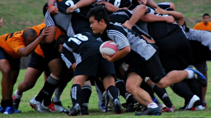 Rugby player making a break with the ball. Photo Credit: Lisa Omarali