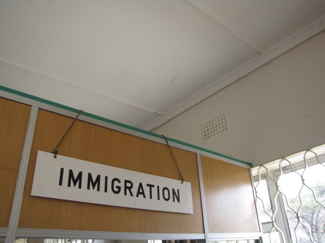 Immigration banner byhttps://www.flickr.com/photos/whatleydude/