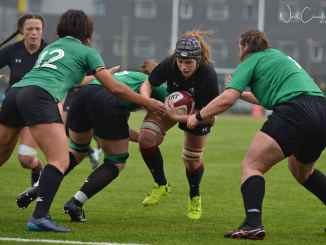 The Welsh women's team break througha tackle in a game against the Irish women's team. Photo credit: Neil Charles Robert.