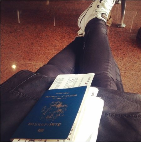 Bianca waiting for new adventures. with her passport in her lap.