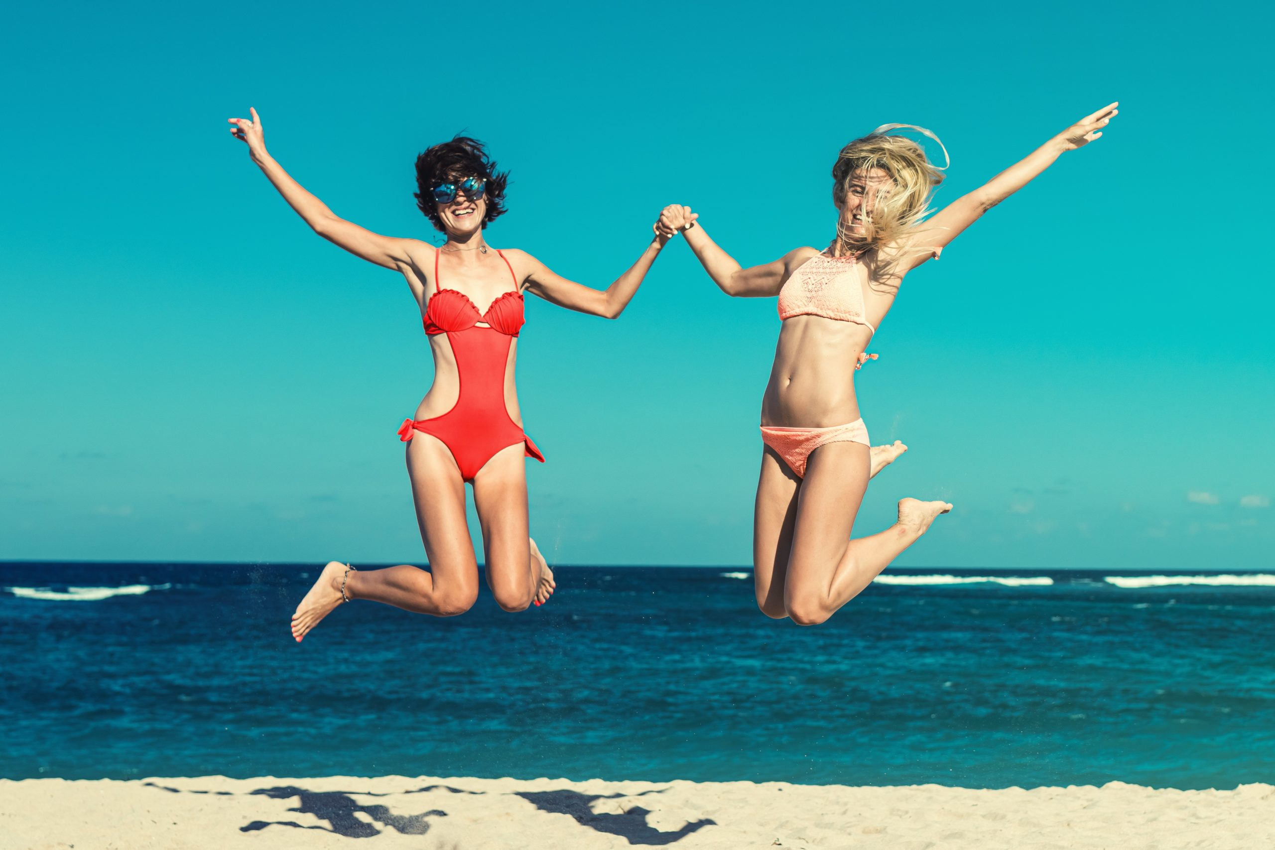 two-woman-in-bikini-jumping-2318057