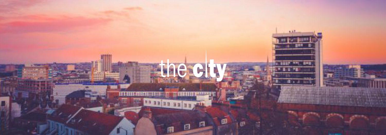 cropped-the-city-logo-1.jpg