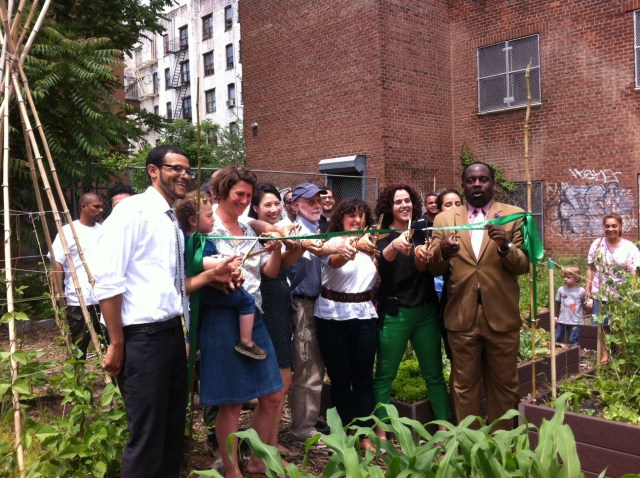 A ribbon cutting for the new Keap Fourth Community Garden in Brooklyn, which was created with 596 Acres' help.