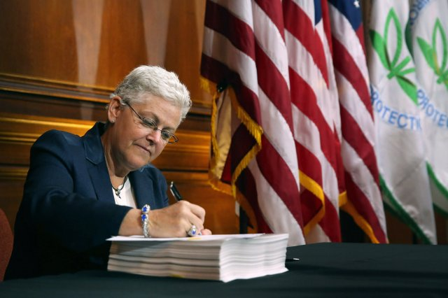 Gina McCarthy, the E.P.A. administrator, signed new regulations for power plants.