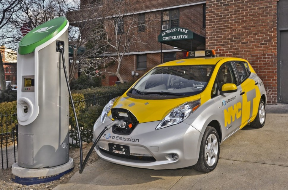 Why aren't we rolling in these already? Nissan Leaf test taxi at a charging station. Photo: Green Car Reports