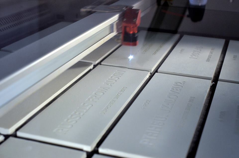Name pool tiles for supporters, being etched.