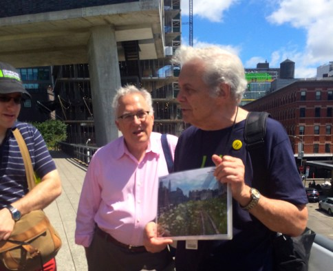 Ken Naarden shows pictures of the original rail line.