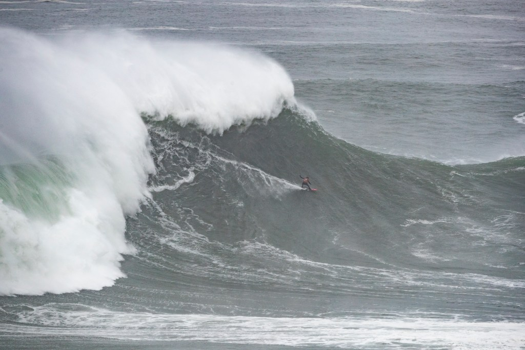 NAZARE, PORTUGAL - FEBRUARY 11: A surfer from Team Atlantic surfing during the 2020 Nazare Challenge on February 11, 2020 in Nazare, Portugal. (Photo by Damien Poullenot/WSL via Getty Images)