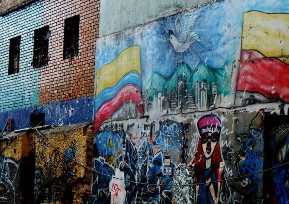 """Graffiti covered walls in the two block """"crime scene"""""""