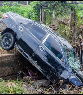 Flood: Three Dead, Vehicles Submerged In Abuja Community {Photos}