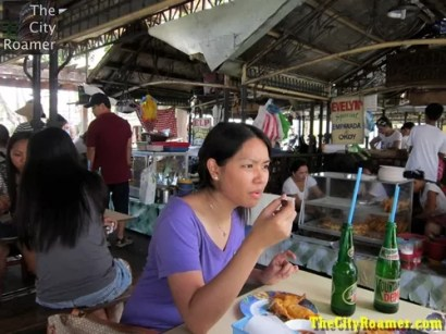 Blogger Cristelle Torres enjoying her Vigan Empanada