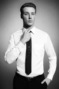 GQ International - Classic Dressing with Necktie worn with a White Shirt and Black Pants