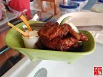 Buffalo Wings served in bathtub at Boracay Toilet