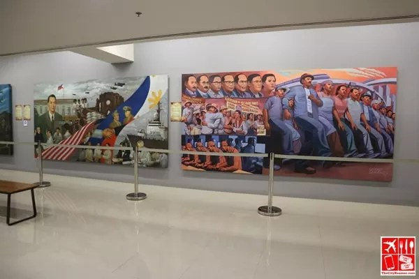 The paintings at SiningLakbay is a collaboration between University of the Philippines and Araneta Center