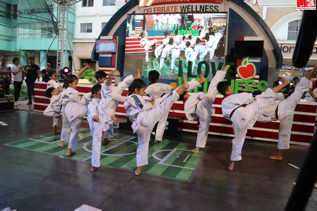 The Diliman Prep School Taekwondo Team at the Robinsons Supermarket Celebrate Wellness kick-off