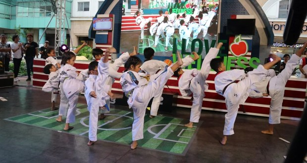 The Diliman Prep School Taekwondo Team at the Robinsons Supermarket Celebrate Wellness kick-off