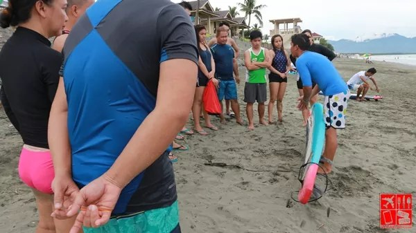 Guests listening intently to the surfing lesson
