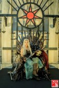 A cosplayer sits at the GOT Iron Throne