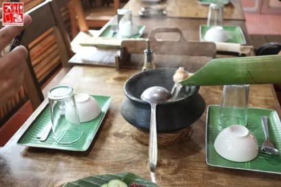 serving a dish cooked in bamboo
